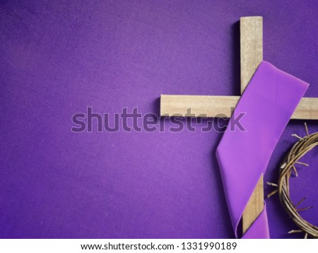 Good Friday, Lent Season and Holy Week concept - A religious cross and a woven crown of thorns on purple background. #1331990189