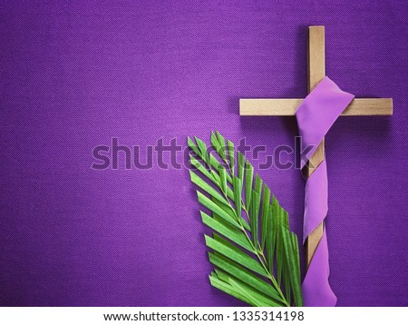 Good Friday, Lent Season and Holy Week concept - A religious cross and palm leaves on purple background. #1335314198
