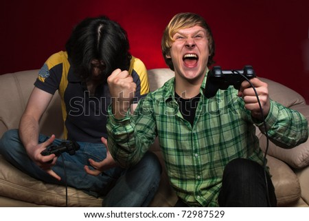 good friends playing video games on a red background stock photo 72987529 shutterstock. Black Bedroom Furniture Sets. Home Design Ideas