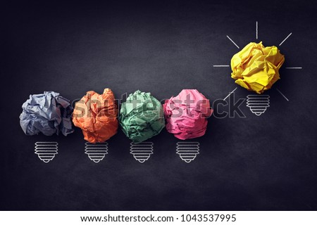 Good idea concept crumpled paper ball lightbulb on blackboard