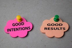 Good Intentions or Good Results write on sticky note isolated on Office Desk. Selective focus on text