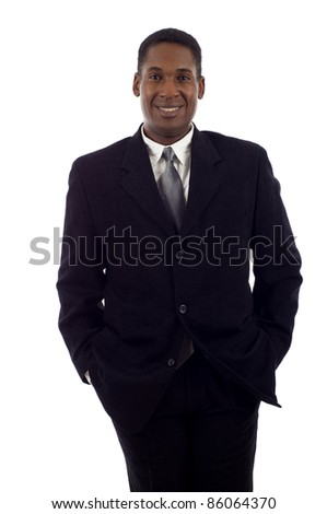 Good looking African American business man standing with hands in pockets isolated white background