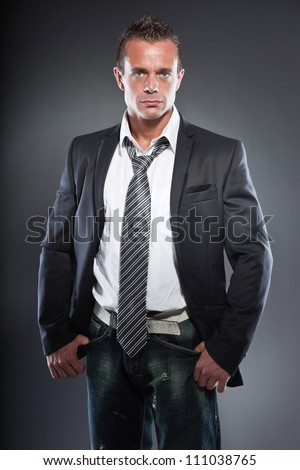 Good looking business man blue eyes and short blond hair. Tough guy. Wearing tie and black jacket.