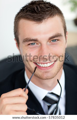 Good-looking businessman with glasses in his office