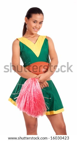 Good-looking cheerleader holding a pom and a rugby ball