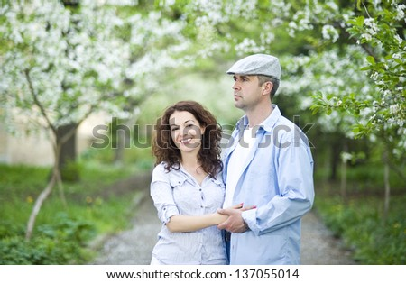 Good looking couple in a spring garden