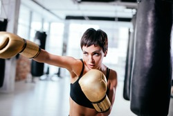 good-looking daring female concentrating on boxing. sparring bout. fighting skills