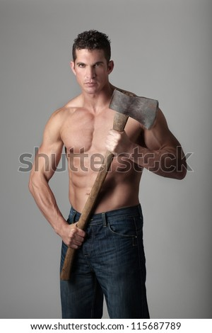 good looking male holding a well used axe to chop wood with
