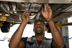 Good Looking Mechanic Checking Out Vehicle