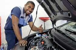 Good Looking Mechanic Giving Thumbs Up And Smiling