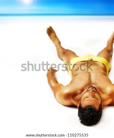 Good looking muscular young man lying outside in sun