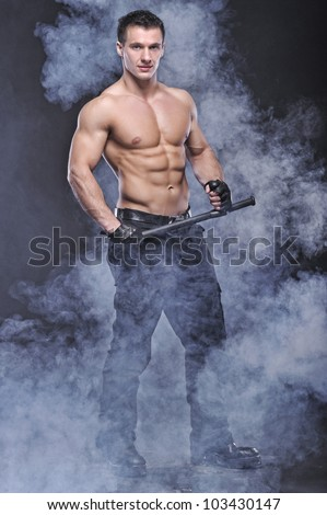 Good looking policeman bodybuilder posing