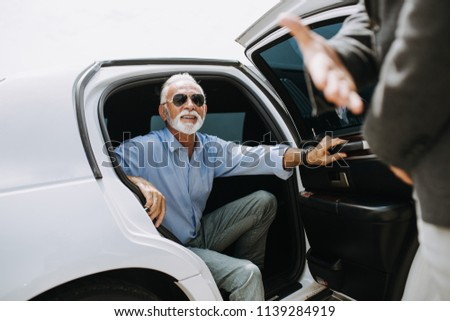 Good looking senior business man  in his limousine. Business concept.