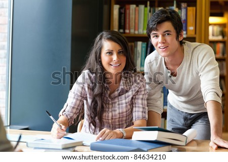 Good looking students posing in a library