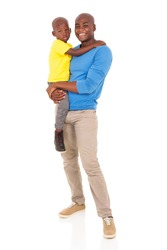 good looking young african man carrying his son
