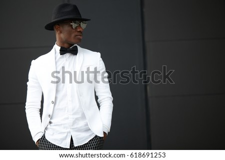 Good looking young black man in trendy clothes #618691253