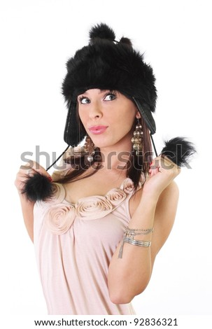 Good looking young woman with a fur winter hat