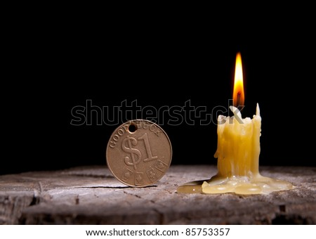 Good luck and a candle on a black background