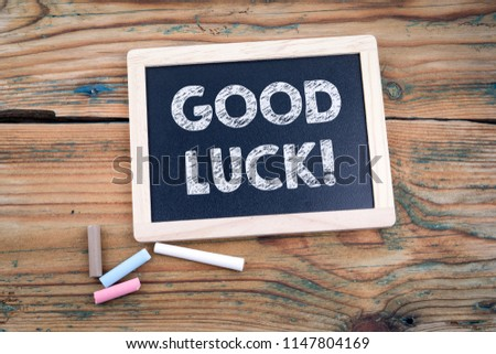 Good luck. blackboard and old wooden table with texture
