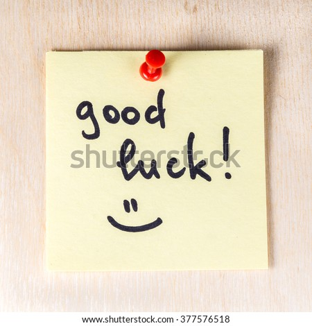 Good luck note on paper post it pinned to a wooden board #377576518