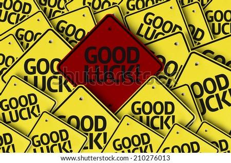 Good Lucky written on multiple road sign