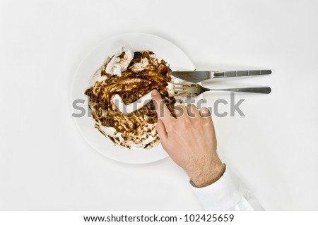 Good meal concept. Man draw check mark in a dirty plate isolated on white from top view.