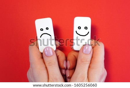 Good mood and bad mood concept with blocks and smiles in a hands  Foto d'archivio ©