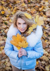 Good mood at any weather. girl on dry fallen leaves background. wear warm clothes. cozy and comfortable. autumn season fashion. beauty and style. woman with long hair in fall forest with leaves