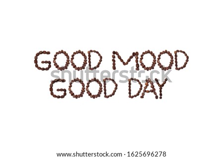 Good Mood, Good Day quote made with roasted coffee beans placed on white background from the top view can use for your messages