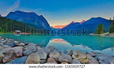 Good mornig Lake Louise.  {Panoramic view of the world famous Lake Louise from shore line to Victoria Glacier.  From the boat rental house to the shore the Chateau Lake Louise. #1165839727