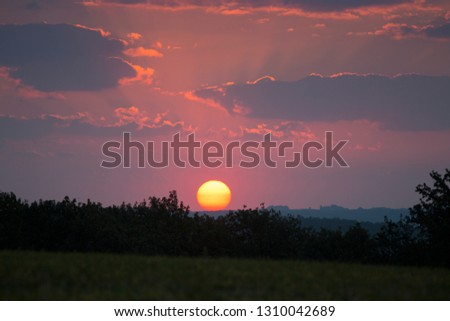 Good morning! Colorful sunrise with big sun ball over the country with lot of sun rays and clouds, beautiful background Picture wirh unbelievable colors and atmosphere, Slovakia