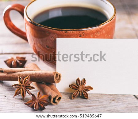 good morning concept. A cup of coffee and spices on wooden table