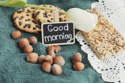 Good morning. Goodmorning blackboard. Rustic morning. Cookies on knitted background. White tulip.