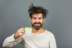 Good morning, happy funny man, smile face. Handsome smiling young guy. Positive human facial expressions and emotions. Smiling hipster man with cup of coffee. Morning concept