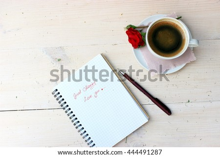 good morning message for love person writing in a notebook and cup of sweet tasty coffee
