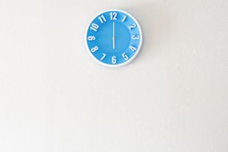Good morning or evening time with 6:00 clock on white concrete wall interior background with copy space, message board concept, 6am is the waking up time, 6pm is the dinner time.