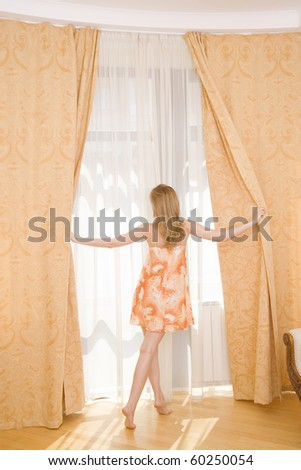 Good Morning ! - woman in bedroom beside window