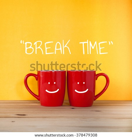 Good morning word. Two cups of coffee and stand together to be heart shape on yellow background with smile face on cup. #378479308