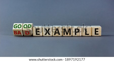 Good or bad example symbol. Turned cubes and changed words 'bad example' to 'good example'. Beautiful grey background. Business and bad or good example concept. Copy space. ストックフォト ©