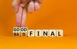 Good or bad final symbol. Businessman turns wooden cubes and changes words 'bad final' to 'good final'. Beautiful orange table, orange background, copy space. Business and good or bad final concept.