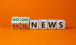 Good or bad news concept. Fliped cubes and changed the words 'bad news' to 'good news'. Beautiful orange background. Business and good news concept. Copy space.