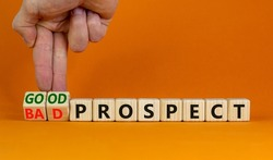 Good or bad prospect symbol. Businessman turns wooden cubes and changes words 'bad prospect' to 'good prospect'. Beautiful orange background. Business, good or bad prospect concept. Copy space.