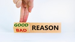 Good or bad reason symbol. Businessman turns cubes and changes words 'bad reason' to 'good reason'. Beautiful white background. Copy space. Business, good or bad reason concept.
