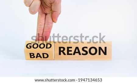 Good or bad reason symbol. Businessman turns cubes and changes words 'bad reason' to 'good reason'. Beautiful white background. Copy space. Business, good or bad reason concept. Photo stock ©