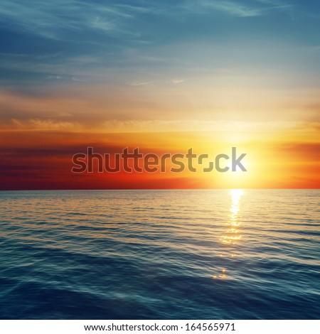 good red sunset over darken sea