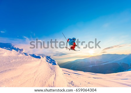 good skiing in the snowy mountains, Carpathians, Ukraine, a beautiful winter sunset, incredible ski jump #659064304