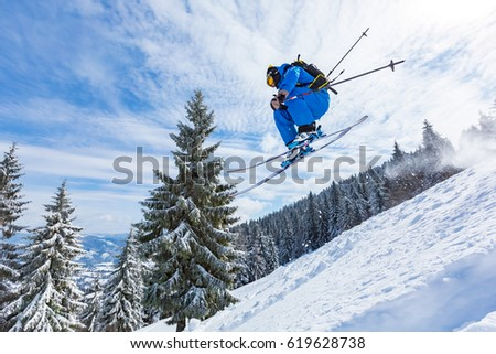 good skiing in the snowy mountains, Carpathians, Ukraine,  good winter day, incredible ski jump #619628738