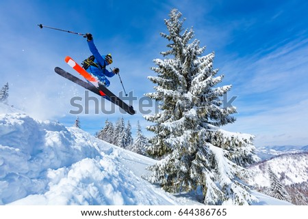 good skiing in the snowy mountains, Carpathians, Ukraine, good winter day, incredible ski jump #644386765