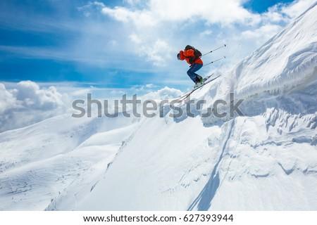 good skiing in the snowy mountains, Carpathians, Ukraine, good winter day, incredible ski jump, ski season #627393944