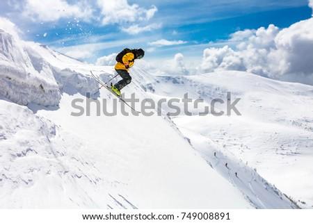 good skiing in the snowy mountains, Carpathians, Ukraine, good winter day, incredible ski jump, ski season